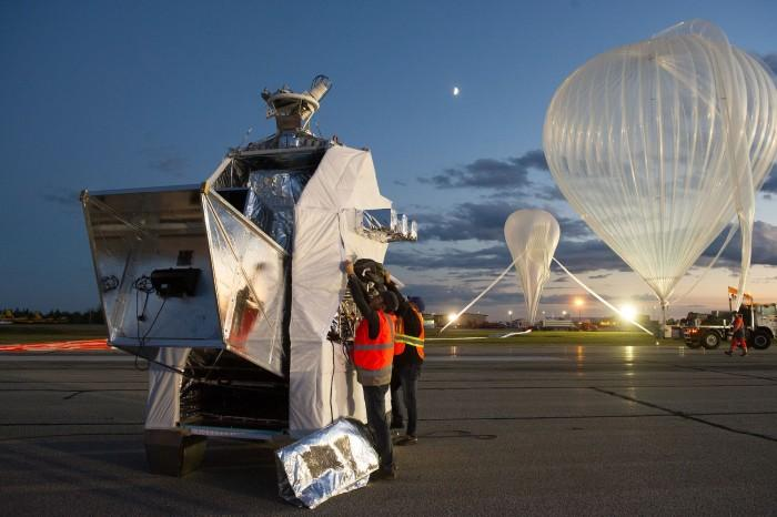 Preparation of the launch of a stratospheric balloon carrying PILOT (foreground, left) to an altitude of some 40km. Designed to map weak polarised light emitted by interstellar dust grains, PILOT cannot operate efficiently from the ground. This launch was made from Canada in September 2015. Credit: CNES / Emmanuel Grimault
