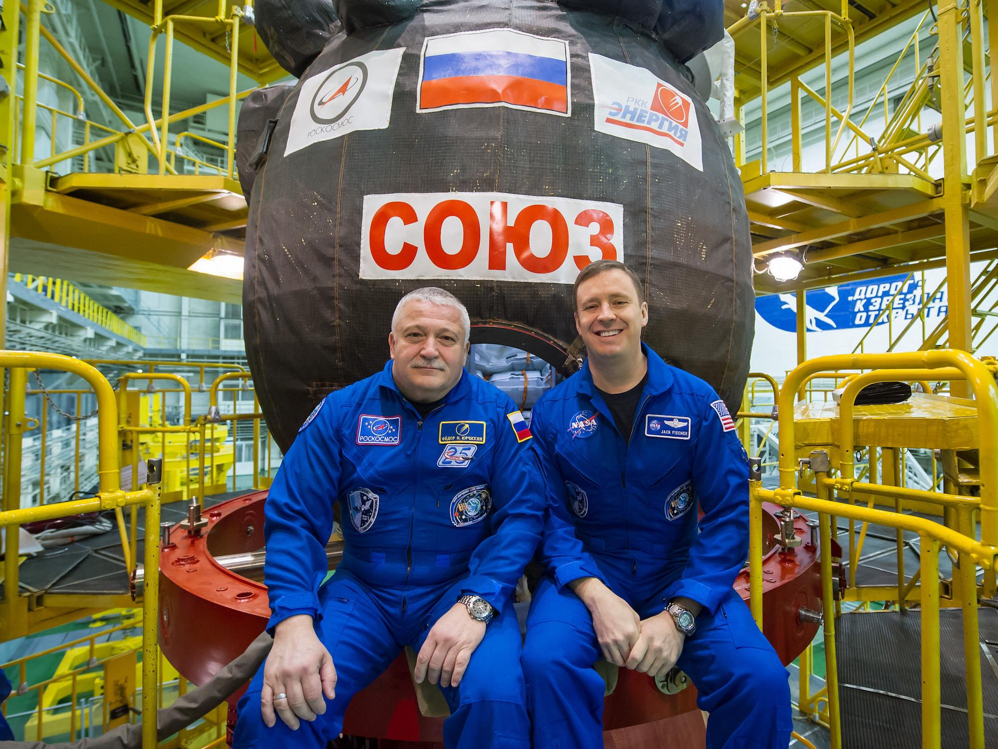In Baikonur, Fyodor Yurchikhin (left) and Jack Fischer stand in front of Soyuz MS-04 which will take them to the ISS on 20 April. Image credit: NASA/Gagarin Cosmonaut Training Center/Andrey Shelepin